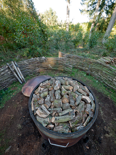 The charcoal kiln fille to the brim with OneOak branchwood