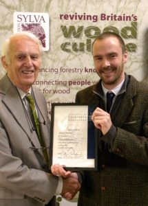 Alistair Yeomans is presented with his Chartered Forester certificate
