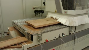 Passing the OneOak wood through the CNC machine