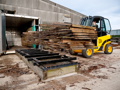 OneOak timber kiln drying. The higher quality and thinner boards are lifted onto trolleys tracks ready to be slid into a small wood kiln at Deep in Wood sawmill.